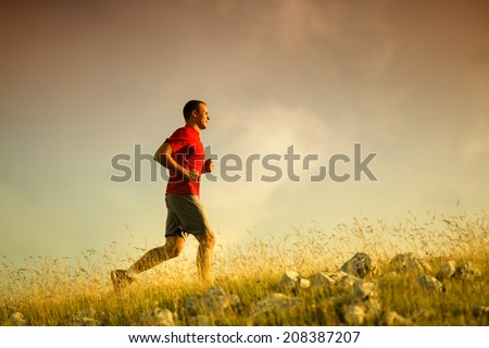 Running fitness man sprinting outdoors - stock photo