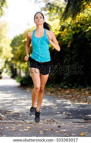 running healthy fitness woman training for marathon outdoors in alleyway. vitality lifestyle run - stock photo