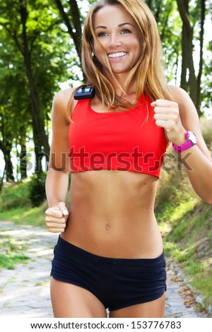 Running in city park. Woman runner outside jogging  - stock photo