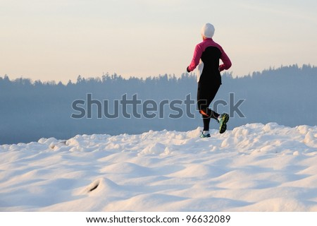 Running in snow - stock photo