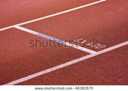 Running lanes on a track in play gorund - stock photo