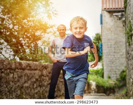 Running little boy portrait - stock photo