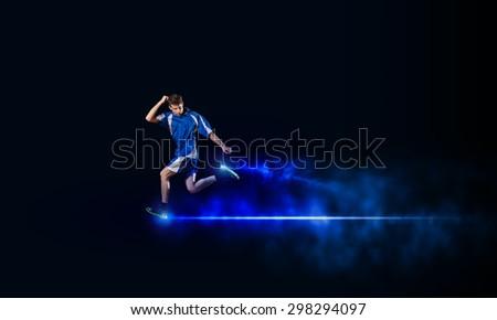 Running man in blue sport wear on black background - stock photo