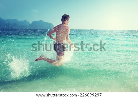 running man in water of tropical sea - stock photo