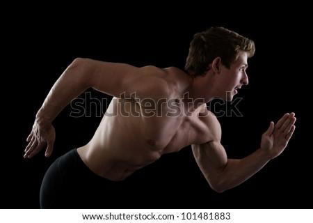 running man.  isolated on dark background - stock photo