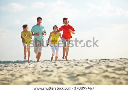 Running on sandy beach - stock photo