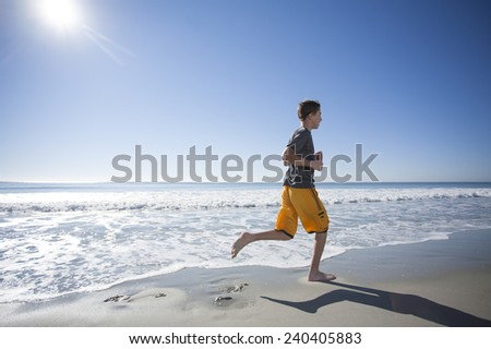 Running on the Beach - stock photo