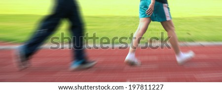Running on the running track - stock photo