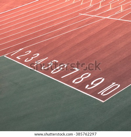 running race track number screen on ground surface - stock photo