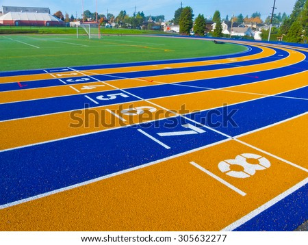 Running race truck, runway with numbered colorful lines. - stock photo