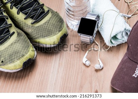 Running shoes and fitness equipment - stock photo