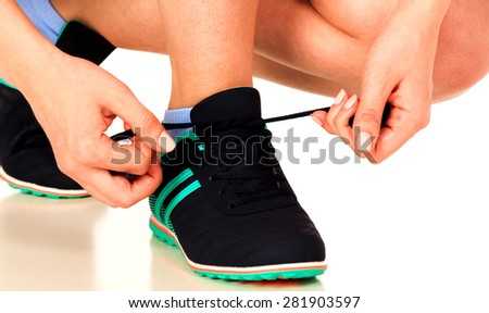 Running shoes being tied by woman, white background, isolated, copyspace - stock photo