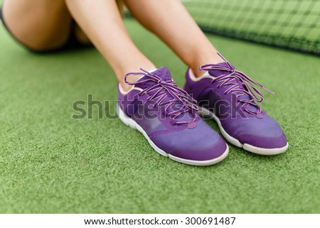 Running shoes on a tennis court background Athletic, health, sports, lifestyle. - stock photo