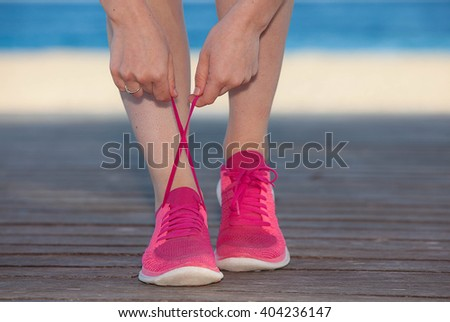 running shoes ,tying trainer laces - stock photo