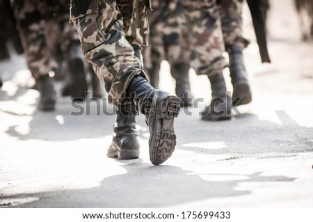 running soldiers carrying weapons - stock photo