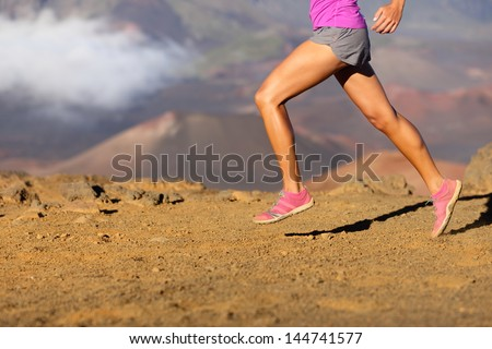 Running sport fitness woman. Closeup of female legs and shoes in action. Girl athlete fitness runner sprinting fast outside in barefoot running shoes. Trail running concept. - stock photo