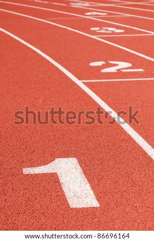 Running track curve with lane numbers - stock photo