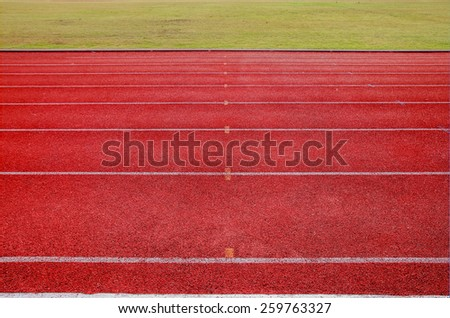 Running track for athletics and competition in the morning - stock photo