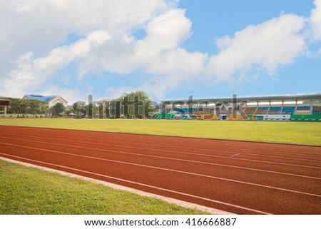 running track in stadium on blue sky for athletics and competition in university - stock photo