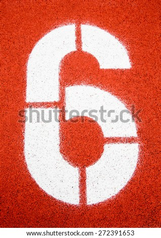 Running track, number 6 - stock photo