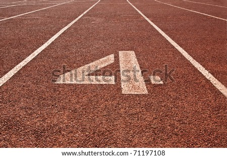Running track number fourth background - stock photo