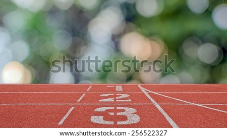 running track number standard red color with bokeh - stock photo