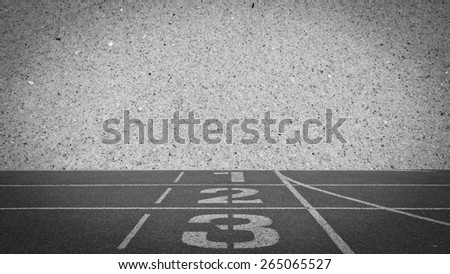 running track number standard with sand beach background, black and white tone - stock photo