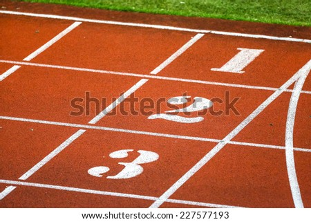 Running track numbers  in stadium - stock photo