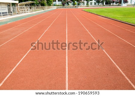Running track with green field, Thailand - stock photo