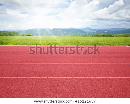 running track with green grass background - stock photo