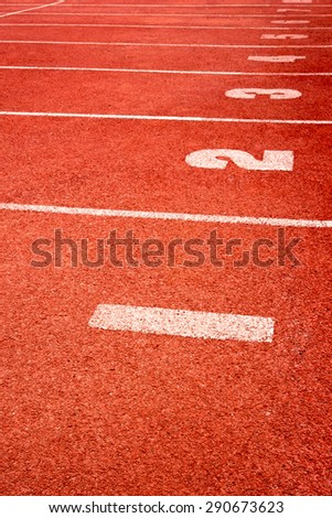 Running track with lane numbers - stock photo