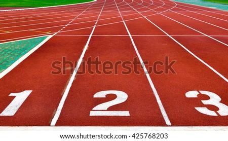 Running tracks with white start numbers - stock photo