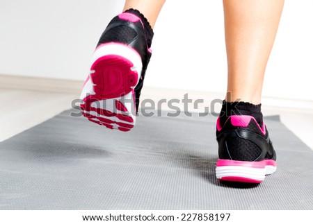 Running woman feet close up - stock photo