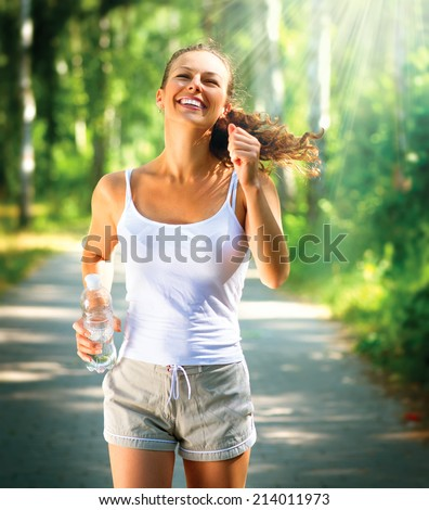Running woman. Female Runner Jogging during Outdoor Workout in a Park. Healthy lifestyle - stock photo