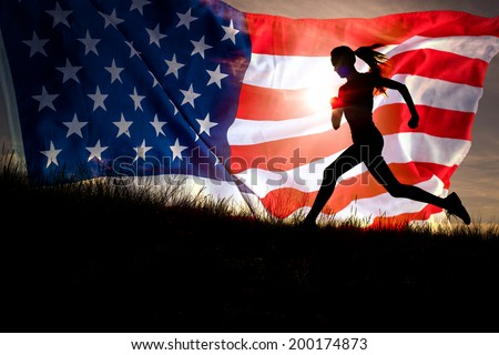 Running woman. Runner jogging over sunset sky and american flag. Female fitness model training outside running to her American dream - stock photo
