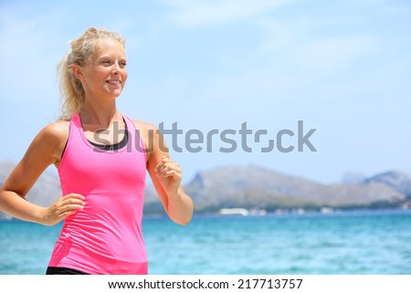 Running woman runner. Portrait of sport fitness girl jogging exercising outside on beach living healthy lifestyle enjoying outdoor activity. Blonde fitness model in her 20s. - stock photo