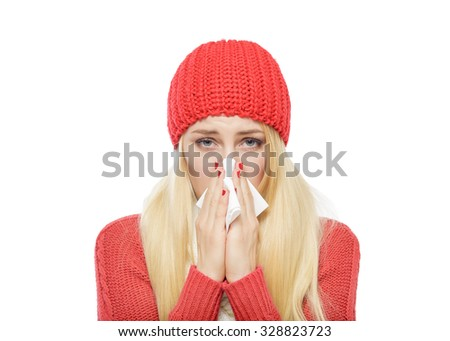 Runny nose of the girl in winter clothes. Isolated on white. - stock photo