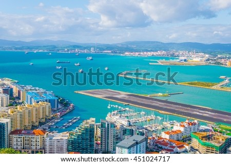runway of the gibraltar airport leading to the atlantic ocean - stock photo