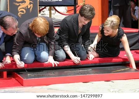 Rupert Grint, Daniel Radcliffe and Emma Watson at Harry Potter Handprint/Footprint/Wandprint Ceremony Grauman's Chinese Theater Los Angeles, CA July 9, 2007 - stock photo