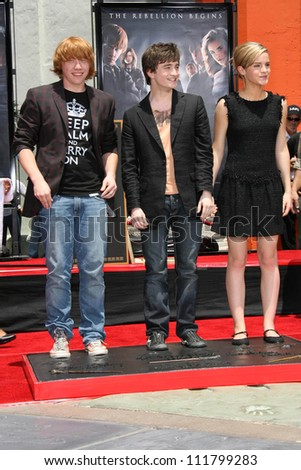 """Rupert Grint with Daniel Radcliffe and Emma Watson at the Hand, Foot and Wand Print Ceremony Honoring The Cast of """"Harry Potter"""". Grauman's Chinese Theater, Hollywood, CA. 07-09-07 - stock photo"""