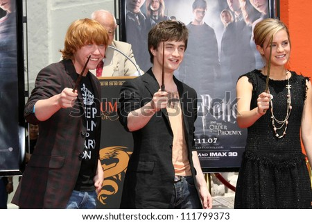 Emma Watson And Daniel Radcliffe Holding Hands Stock Images similar t...
