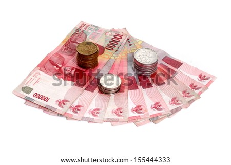 rupiah with measure tape - stock photo