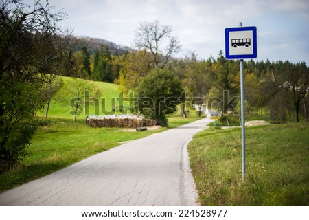 Rural bus stop. - stock photo