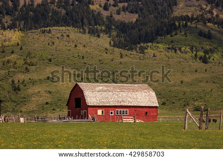 Rural farm and barn in Star Valley, Wyoming, USA. - stock photo