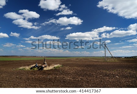 rural field in spring with the installation of irrigation, - stock photo