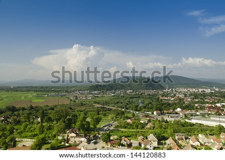 Rural fields and houses in Transcarpathia, Mukacheve,  Europe. - stock photo