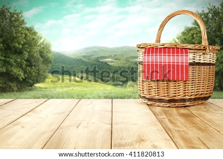 rural landscape and picnic basket and summer time  - stock photo