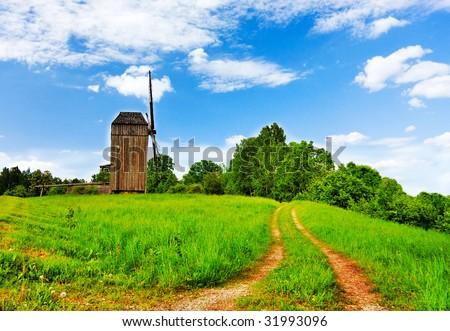 Rural landscape road windmill - stock photo