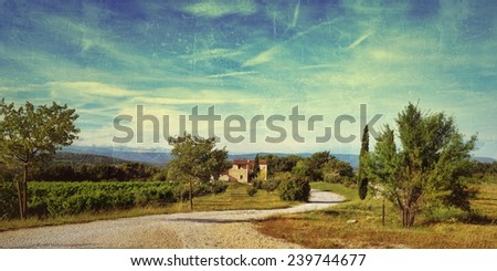 Rural landscape with old farmhouse and dirt road at sunset warm light. Provence, France. Filtered image, vintage effect applied - stock photo