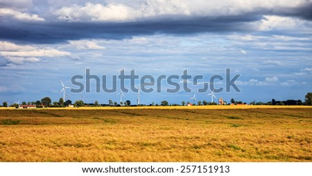 Rural landscape with wind turbine towers.  - stock photo